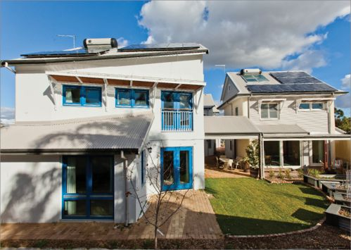 Two townhouses and two apartments have extensive energy saving features, including solar panels and solar hot water systems. The garden between the homes includes lawn as well as raised garden beds.