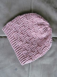 This pattern is a twist on the traditional basketweave stitch. It knits up quickly and makes a perfect unisex hat. It is simple enough to knit up, but has enough patterning to keep you interested. The stitch is easily memorized and Malabrigo Twist knits up like a dream.