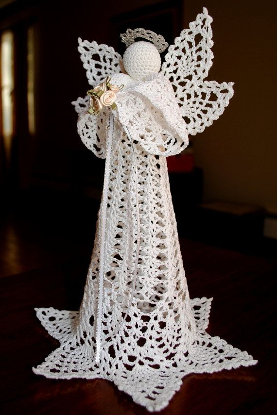 Crochet Christmas angel, tree topper, white with a silver halo holding flowers