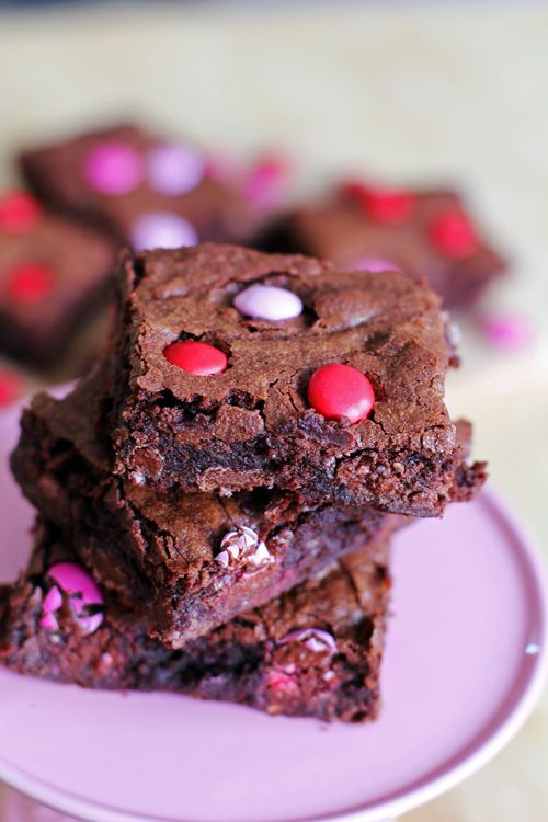"GO MAKE THESE NOW!!! I just made them and they are DELISH!!! ""The Best Ever M&M Brownies. Happy Valentine's Day!!"""