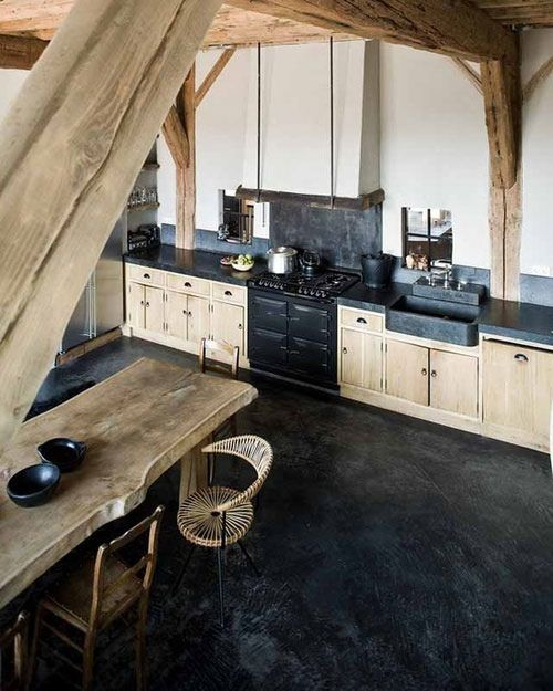 black cement floor & black/natural wood kitchen