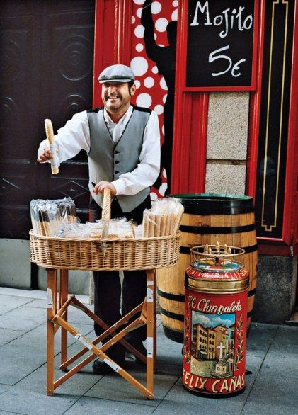 A street vendor in the traditional chulapo outfit sells barquillos, a kind of sugary cookie. Madrid Spain