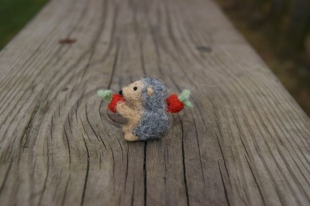 This tiny felted hedgehog has been hand felted using needle felting technique - which means hours of thorough work converting a pile of loose wool fibres into the final mini size hedgehog. Ideal...