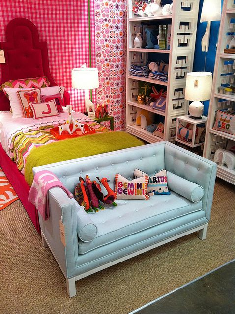 Johnathan Adler kid's room display. That couch is fabulous.