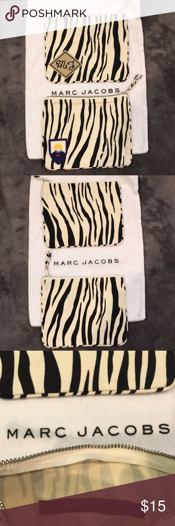 Marc Jacobs Zebra Print Cloth Bag Authentic Marc Jacobs Zebra Print Cloth Bag never been used in excellent condition.  $15 each // or // 2 for $20 (while supplies last) Marc By Marc Jacobs Bags