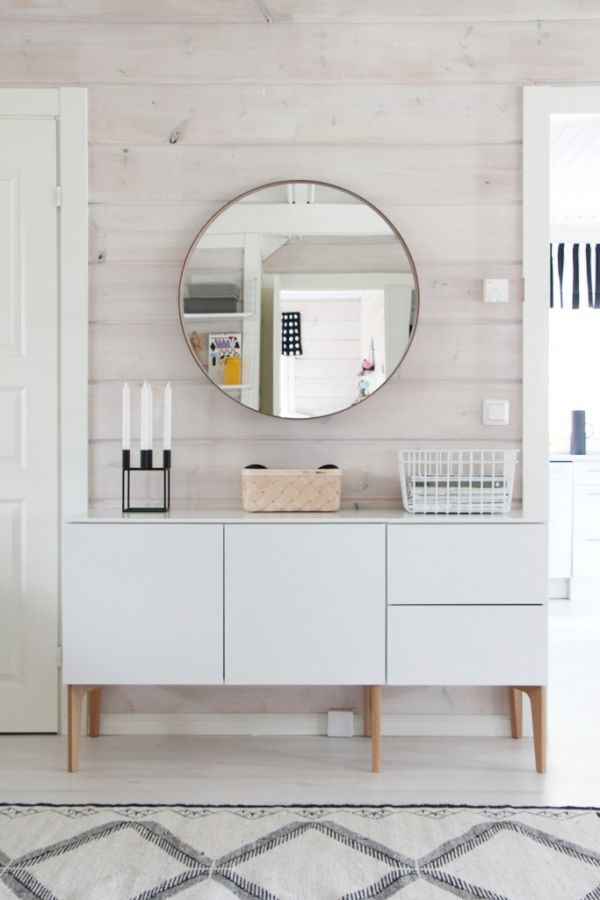 Sideboard #cabinet and round #mirror surrounded and enriched in #white