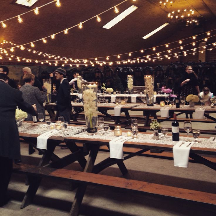 O&S's barn wedding in #Banff! Cafe lights, picnic tables, white florals, Mercury candle holders, and runners. #seweddings