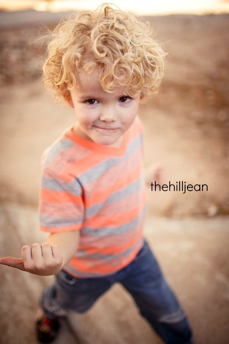 Long style toddler. Curly Boy. Longer hairstyle, heavily layered to give hairstyle shape and encourage curls.