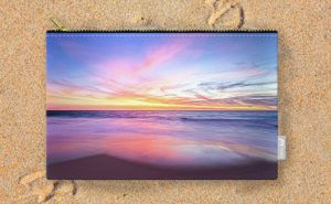 Aussie Sunset, Claytons Beach Carry-All Pouch design by Dave Catley featuring a…