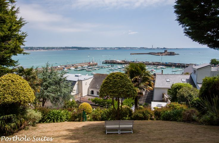 The view of St Aubins Bay from Porthole Suites' amazing gardens. St Aubins Fort is on the right, Elizabeth Castle is across the bay and straight ahead.