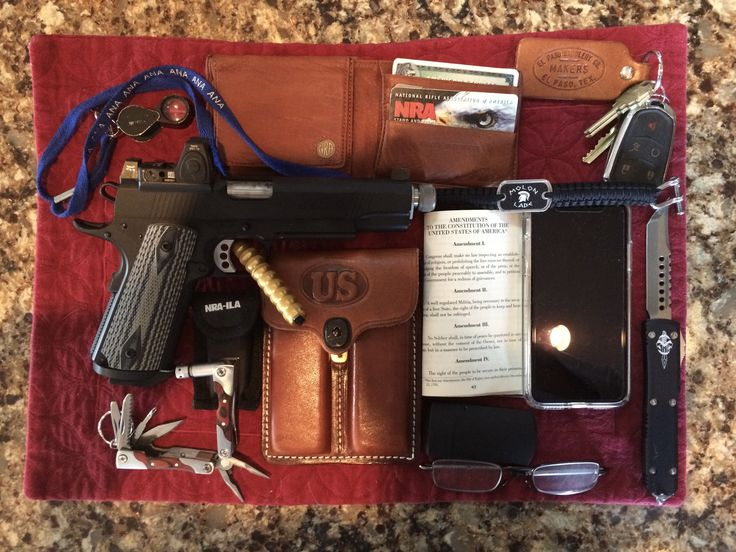 My Heavy Duty Every Day Carry (HDEDC): well worn Cato Institute copy of DoI & Constitution, Foster Grant 2X spectacles w/case, MicroTech Halo knife, Molon Labe paracord bracelet, car keys w/ El Paso Saddlery keychain, American Bison NRA billfold w/ Benefactor Life Member card & CCW permit, Ed Brown 1911 Special Forces SR w/ Trijicon RMR sight in 45 ACP, 2 extra mags in El Paso Saddlery case w, BenchMade tactical pen, NRA-ILA multi-tool, American Numismatic Association (ANA) 10X loupe w…