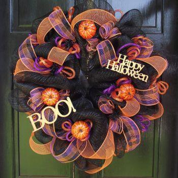 Halloween Front Door Decor Ideas - how to decorate the front door and porch area this October. Image: Halloween BOO wreath.