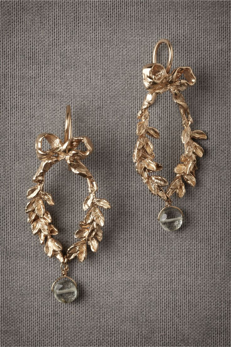"""Gilded bows hold together leafy garlands that rejoin in an amethyst kiss. From Christina Zazo. 1.75""""L, 1""""W. 18k gold plated brass, green amethyst. Handmade in Spain."""