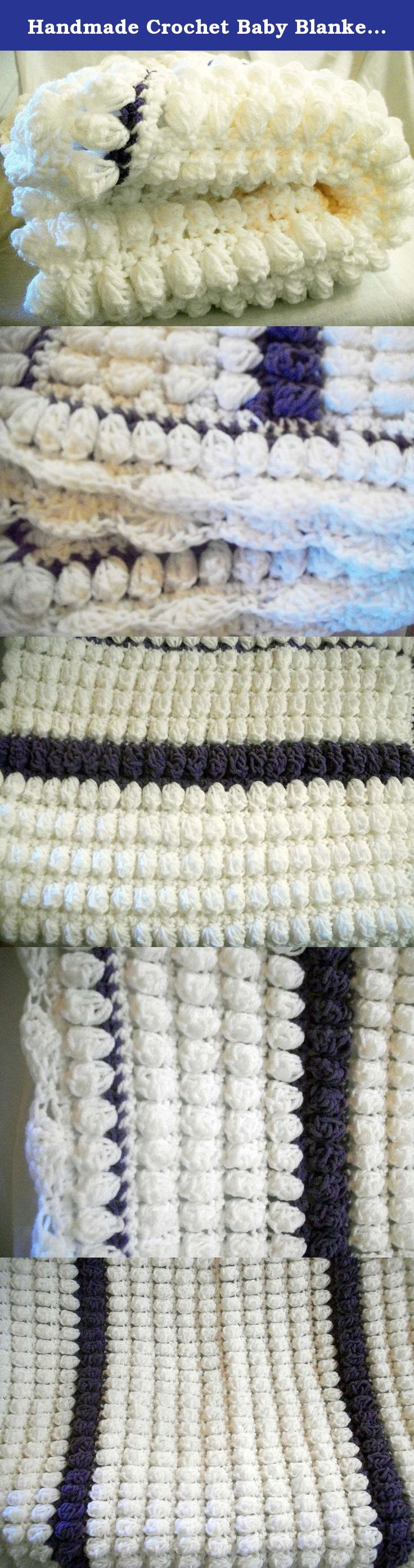 """Handmade Crochet Baby Blanket in White and Purple Popcorn Stitch by DRCrafts. This cute little baby blanket is perfect for bringing baby home from the hospital, to give as a baby shower gift, or even to cover baby in the stroller or car seat. Made with the popcorn stitch, it is thick and warm, made in white with purple. Machine wash and dry, no bleach. Use warm, gentle settings. Do not dry clean. It measures approx. 36"""" wide and 27"""" high."""