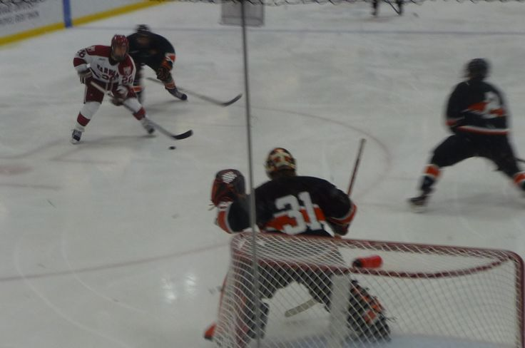 Harvard hockey opens the 2011-12 campaign against Princeton. Tigers take it, 4-3.