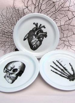 creepy vintage illustration heart skeleton hand skull plate black and white halloween