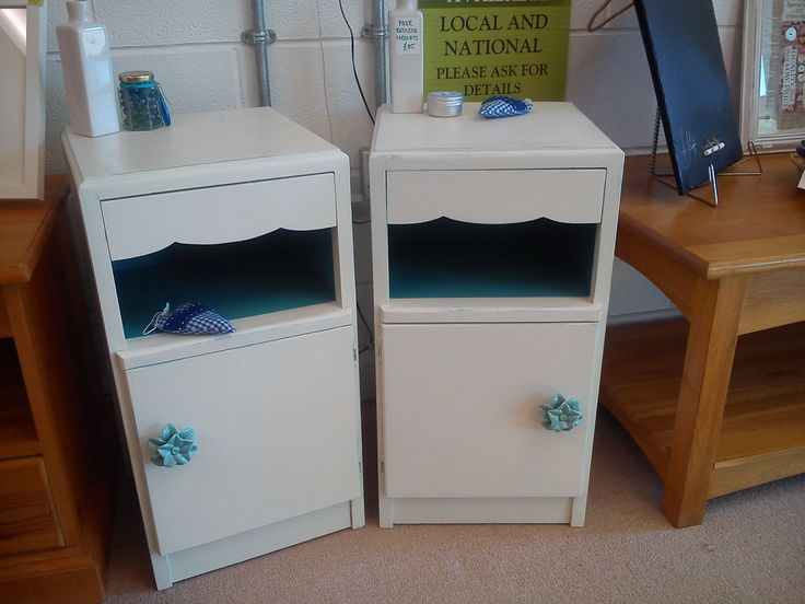 Bedside cabinets, white with a blue scrub back effect, blue ceramic flower handles.