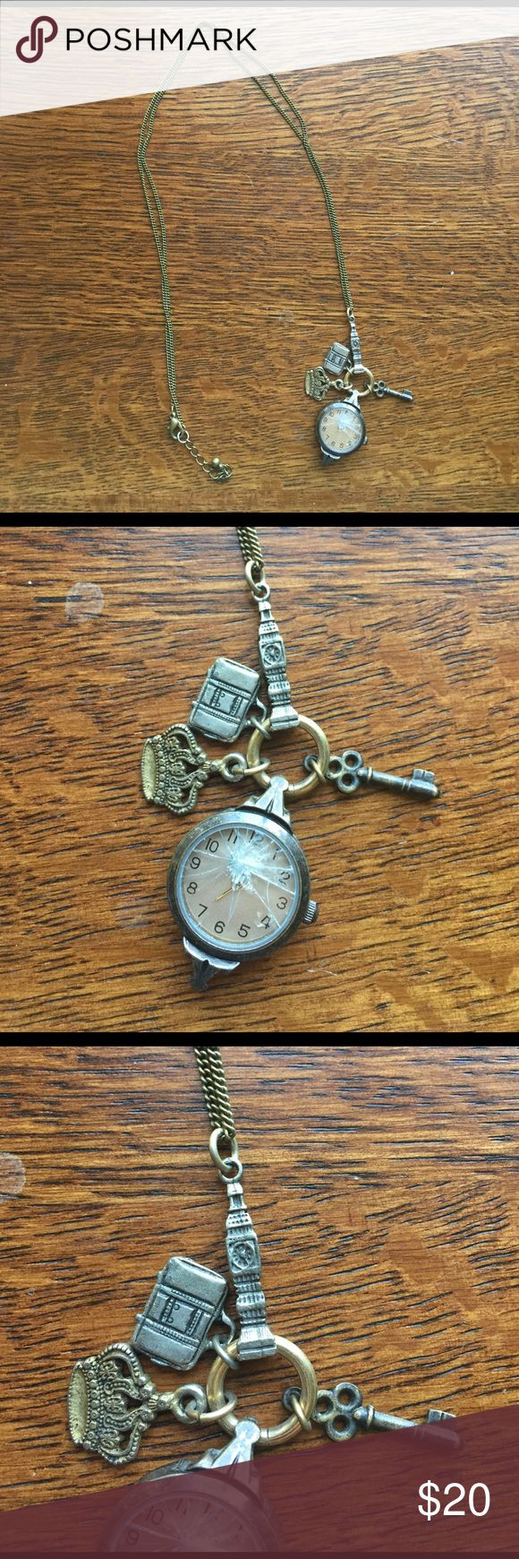 Anthropologie bronze British themed clock necklace Awesome bronze British themed clock necklace! The glass on the clock is broken but I believe it is an easy fix for any watch specialist. The clock did work originally; however, it needs a new battery I believe. Super cute charms of Big Ben, the Royal Crown, a vintage key, and a suitcase. Priced appropriately for damage. Anthropologie Jewelry Necklaces