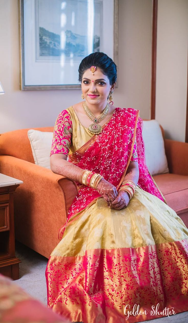 Besides reds, pinks and subtle shades have become the favourite go-to shades for most brides these days. They have started to make it a point to stand out of the crowd almost in every way possible. Here is one such bride who looks like royalty. Literally! Her makeup, outfits, hairstyle and more over the charming and soothing smile she sports on her pretty face is proof that her bridal glow is kicking in big time. As she rejoices beautifully over her most joyous of times ever, we can't for...