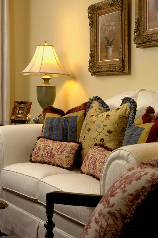 Living Room by Paula Grace Design. Love the pillows and classic details.
