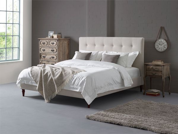 The overall design is fairly plain and minimalistic but features a single row of buttons on the headboard and tall walnut feet adding a touch of elegance to any room.  We design and manufacture all of the beds in our UK factory using the highest quality materials. Our expert craftsmen use solid beech wood and premium fabrics to ensure that when your bed is delivered it is in prime condition and guaranteed to stand the test of time in your bedroom.