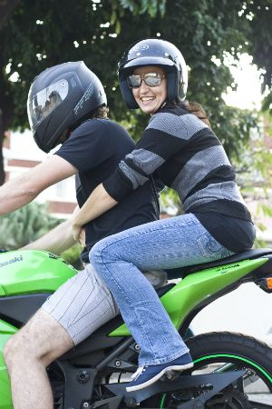 """""""Can you believe it… this is the first time I'm ever riding on the back of a motorbike!"""" - Claire"""