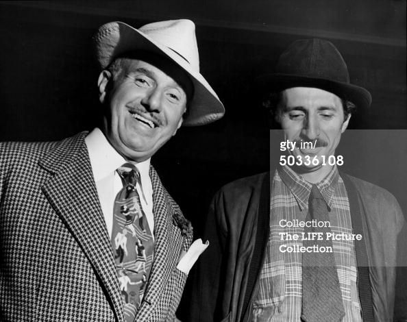 1944: Photographer Gjon Mili (R) w. Warner Bros. Studios head Jack L. Warner on set of Jammin' the Blues, film being directed by Mili. (Photo by Gjon Mili//Time Life Pictures/Getty Images)