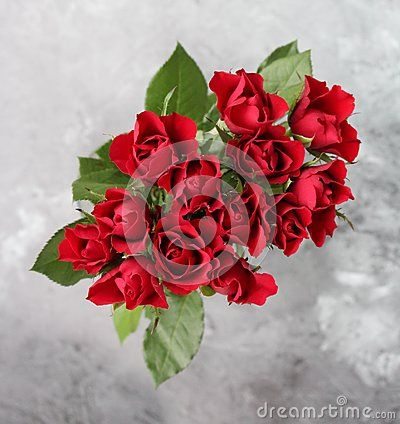 A bunch of red roses with marble background