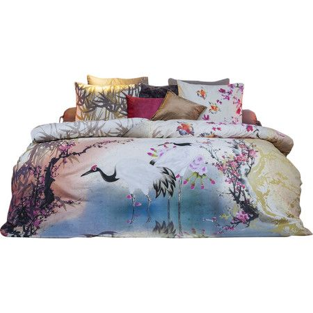 Brighten your master suite or guest bedroom with this eye-catching cotton duvet set, featuring an exotic botanical design. Product: