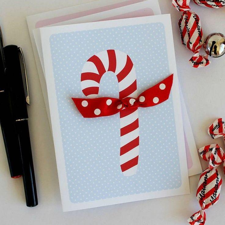 Weihnachtskarte mit Zuckerstange und Schleife