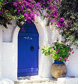 Door entrance with flowers in Parikia, Paros.  Greece