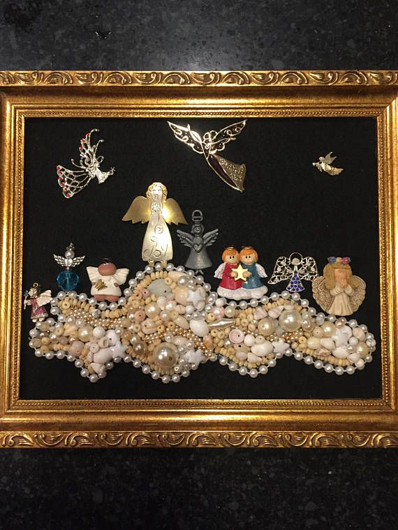 This is 100 percent recycled jewelry art angel picture. I start by glueing black felt on cardboard backing and then I securely glue the jewelry on the fabric. The jewelry ranges from contemporary to vintage. I use beads and pearls from shells, wood, metals and plastic. The angels