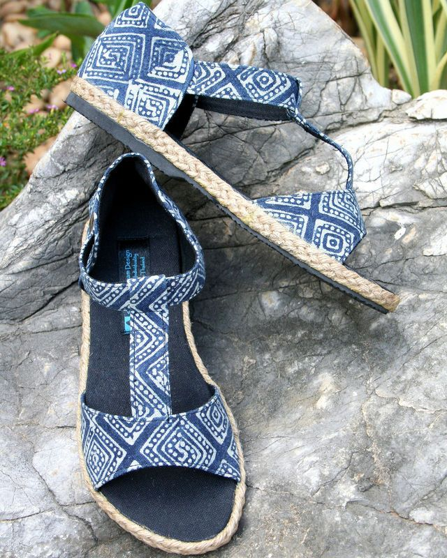 Lindsay T-Strap Women's Sandals. Hmong hand stamped indigo batik on a vegan woman's sandal.HandmadeHmong indigo batik cotton uppers Single ankle strap with brass snap closureRubber soleBlack cotton insoles7/8/2.22 cm woven rope trimmed heelYour ch...