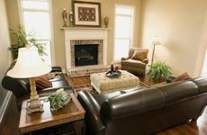 Dark leather couches should be accentuated by lighter surroundings.