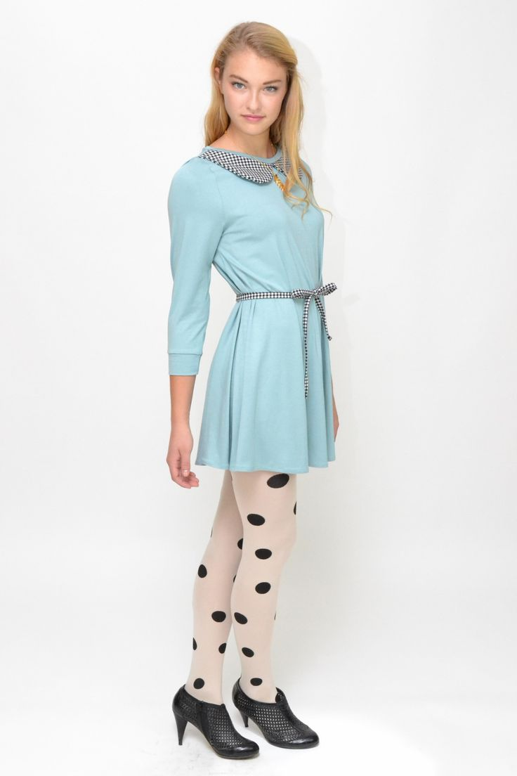 Soft pale blue tunic dress with 3/4 sleeves. Peter pan cotton gingham collar and matching belt tie. Wear without or with the belt tied around the waist for a more fitting silhouette. Tartan detail at sleeve.