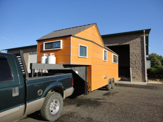 Clothesline Tiny Homes 8 x 24. Building it on a 5th Wheel / gooseneck trailer enabled it to have a lower overall height, a more aerodynamic front end (facilitating less stressful towing), and a more spacious bedroom. The bedroom is located over the gooseneck hitch.