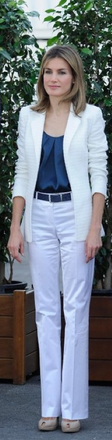 Letizia pair her favourite white pants with royal blue top and textured white blazer