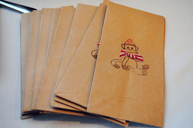 *darling* sock monkey stamped kraft bags with ribbon bow  {supplies from Hobby Lobby}