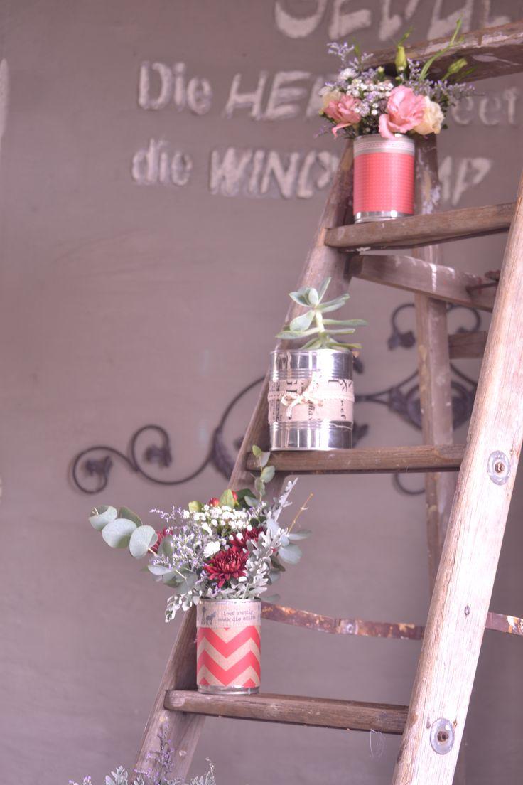 Absolutely loving the rustic ladder flower arrangement