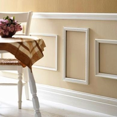 If you're looking for an easy way to get the look of decorative molding, why not repurpose frames as a wall treatment?