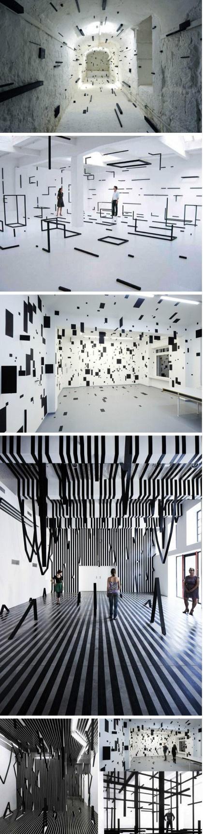 建筑设计项目#切实的模糊空间,意大利艺术家 Esther Stocker 设计,逻辑是模糊的,不稳定是常在的,冲突是一定的,模糊的感觉应运而生。采用黑色的纸板和钢材打乱感官,创造出错置的空间,模糊的空间