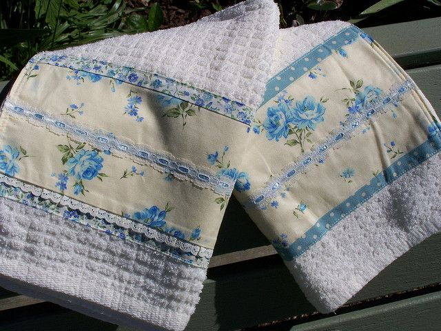 A set of two blue and cream tea towels. Draped over the back of an old garden bench. So pretty for the blue and cream kitchen. See my profile page for Shop link.