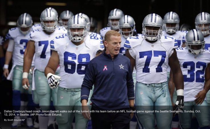 Jason Garrett leads the Dallas Cowboys out of the tunnel in 2014 vs the Seahawks in Seattle, which the Cowboys won. Via the Dallas Morning News. #Dallas #Cowboys #DallasCowboys #NFL #NFC