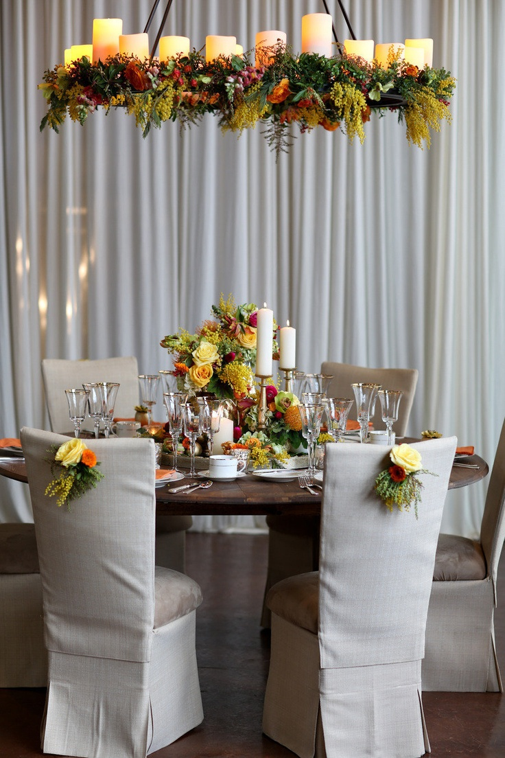 Fall wedding table with amazing overhead flower and candles