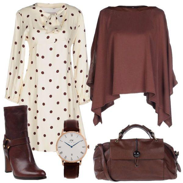 Per questo outfit: vestito panna a pois marroni con fiocco al collo, mantella morbida marrone, stivaletto tacco alto, maxibag marrone e orologio da polso abbinato.