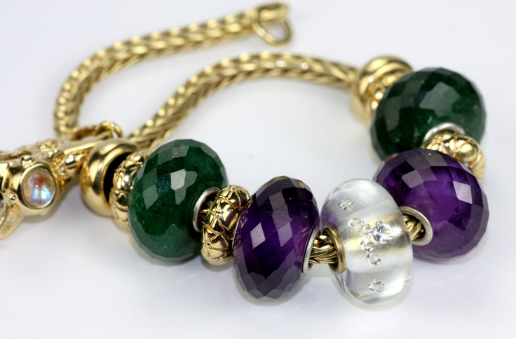 Natural stone Trollbeads on a gold chain.