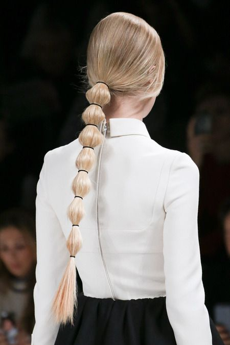 Interesting way to gently pull back long hair and still show off the length | Valentino Fall 2014