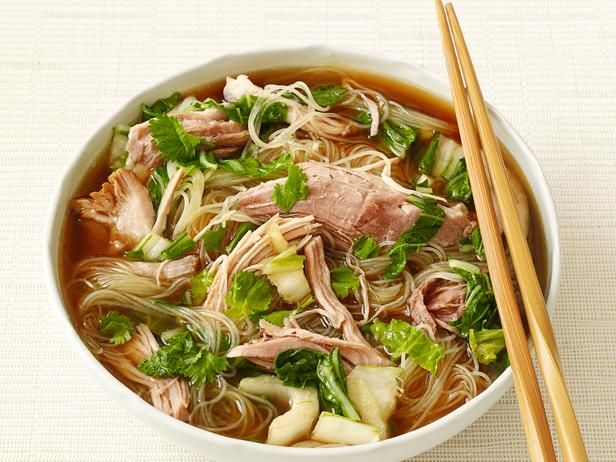 Start your slow-cooker and warm up to a big bowl of this Asian-style soup. Succulent pork shoulder is braised in a flavorful broth and finished with fresh bok choy and rice noodles.