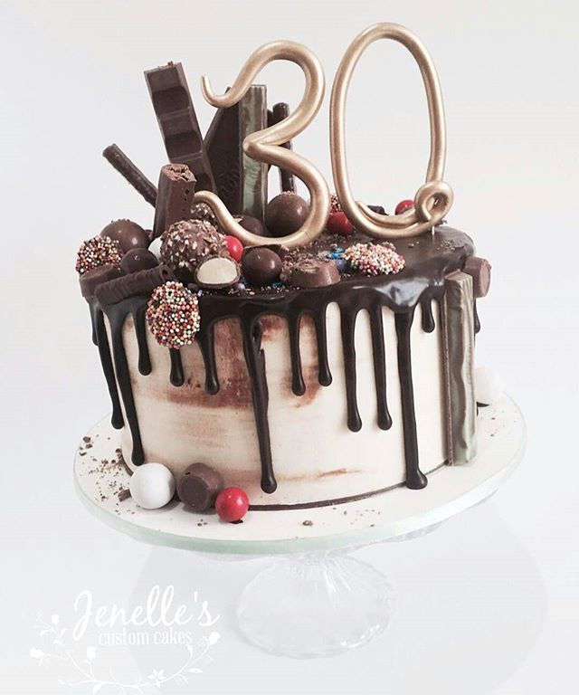 White chocolate mud cake with white chocolate ganache and dark choc drip. Topped…