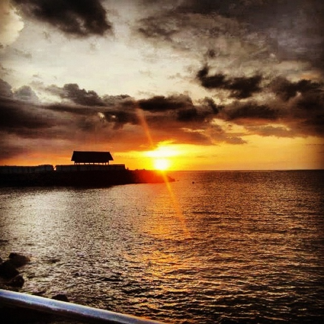 sunset in the beach malalayang beach manado